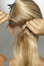 Clip in the centre first after separating the hair.